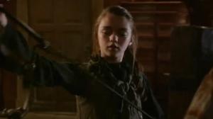 "Arya examining her blade, Needle, in HBO's ""Game of Thrones."""