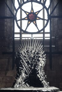 The Iron Throne as depicted in the HBO series, with the star of the seven behind.
